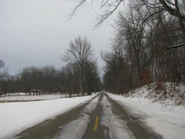 Winter often provides a unique sense of solitude along country roads.